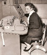 1956 Miss Bernice Bieganski with electric typewriter Detroit MI OM.jpg (156216 bytes)