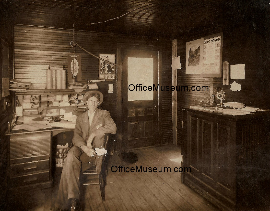 1911 Man At Roll Top Desk In Wood Panelled Office Om Jpg 302655 Bytes